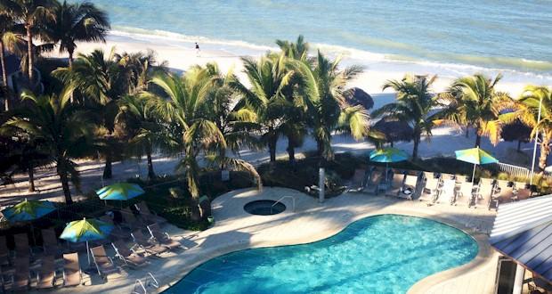 Beautiful beach image of Naples FL, #palmtree #beach, FLTravelLife.com